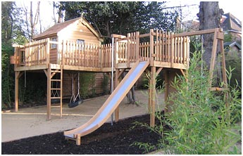 2 station platform treehouse with 6' x 6' cedar cottage, slide, tyre swing, wooden swing, climbing wall and fireman's pole